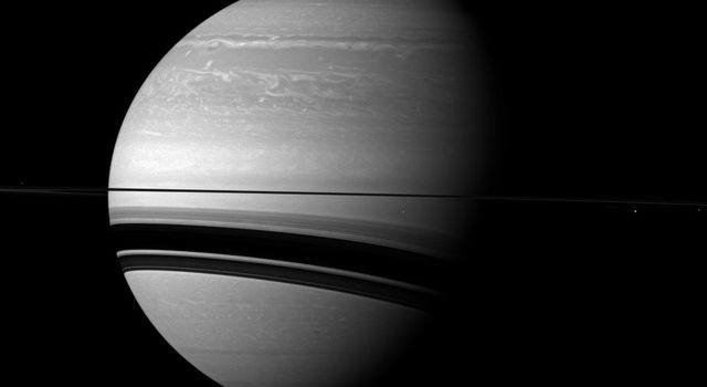 NASA's Cassini spacecraft examines Saturn and the planet's northern hemisphere, which was ravaged by a huge storm for much of 2011.