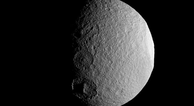 NASA's Cassini spacecraft takes a close look at a row of craters on Saturn's moon Tethys during the spacecraft's April 14, 2012, flyby of the moon. Three large craters are visible along the terminator between day and night on Tethys.