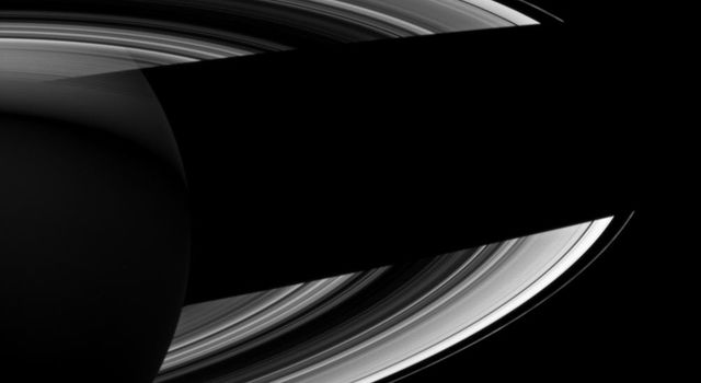 Saturn casts a wide shadow across its rings in view from NASA's Cassini spacecraft which looks toward the darkened southern hemisphere of the night side of the planet.
