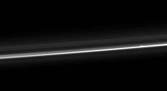 NASA's Cassini spacecraft captures Saturn's ever-changing F ring, showing its bright core, another strand of ring material, and a breakaway clump of material close to the core.