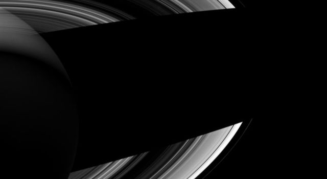 Saturn's small moons Atlas, Prometheus, and Epimetheus keep each other company in this image from NASA's Cassini spacecraft of the planet's night side. It seems fitting that they should do so since in Greek mythology, their namesakes were brothers.