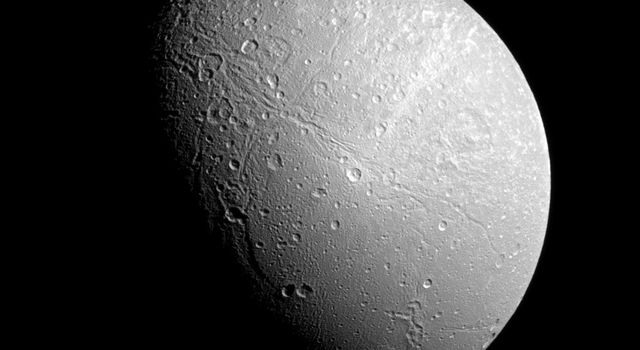 The famed wispy terrain on Saturn's moon Dione is front and center in this recent image captured by NASA's Cassini spacecraft. The 'wisps' are fresh fractures on the trailing hemisphere of the moon's icy surface.
