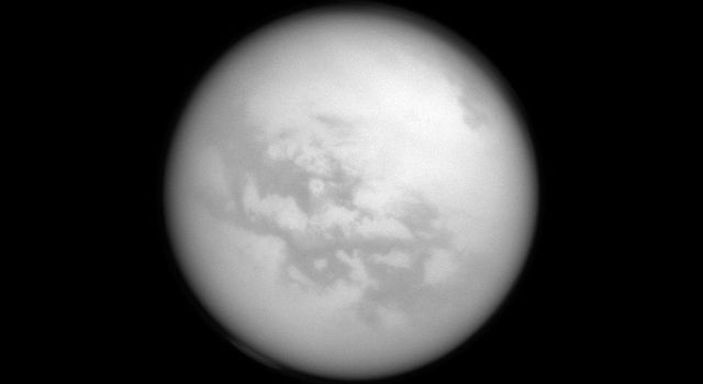 Although hidden from human eyes, NASA's Cassini spacecraft can spot these dark features on the surface of Titan dubbed 'Fensal' and 'Aztlan.' The dark features are believed to be vast dunes of particles that precipitated out of Titan's atmosphere.