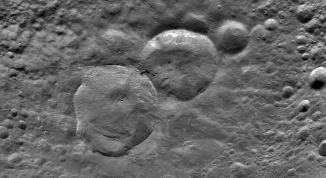 This image from NASA's Dawn spacecraft shows a detailed view of three craters, informally nicknamed 'Snowman' by the camera's team members.