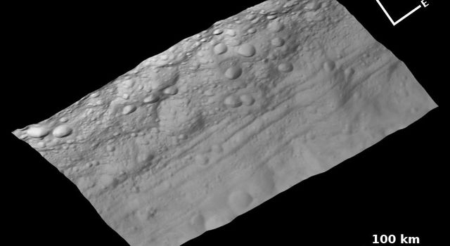 This view of the topography of asteroid Vesta's surface is composed of several images obtained with the clear filter in the framing camera on NASA's Dawn spacecraft on August 6, 2011. The image has a resolution of about 260 meters per pixel.