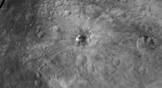 NASA's Dawn spacecraft obtained this image of various craters on asteroid Vesta with its framing camera on August 19, 2011. The image has a resolution of about 260 meters per pixel.