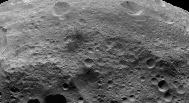 NASA's Dawn spacecraft obtained this image of dark material on hilltops on asteroid Vesta with its framing camera on August 18, 2011. The image has a resolution of about 260 meters per pixel.