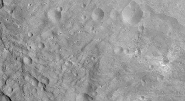 NASA's Dawn spacecraft obtained this image of craters and grooves in the south polar region on asteroid Vesta with its framing camera on Sept. 3, 2011. The image has a resolution of about 220 meters per pixel.
