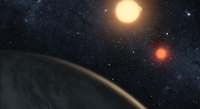 This artist's image illustrates Kepler-16b, the first directly detected circumbinary planet, which is a planet that orbits two stars.