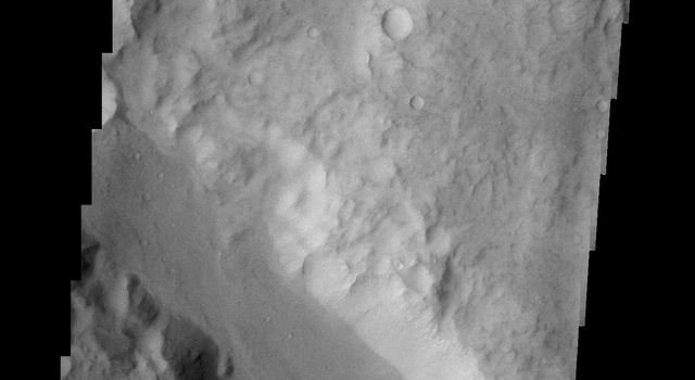 The channel crossing this image from NASA's 2001 Mars Odyssey spacecraft is called Ma'adim Valles.