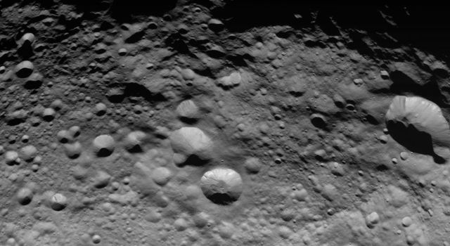 NASA's Dawn spacecraft obtained this image of the giant asteroid Vesta with its framing camera on Aug. 14 2011. This image was taken through the camera's clear filter. The image has a resolution of about 260 meters per pixel.