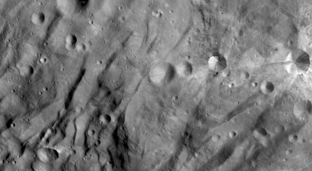 NASA's Dawn spacecraft obtained this image of asteroid Vesta with its framing camera on Sept. 09, 2011. This image of the south polar region was taken at a distance of 864 miles (1,390 kilometers). The image has a resolution of about 130 meters per pixel.