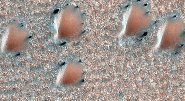 This image from NASA's Mars Reconnaissance Orbiter depicts a scene from early spring in the northern hemisphere of Mars. These dunes are covered with a layer of seasonal carbon dioxide ice (dry ice).