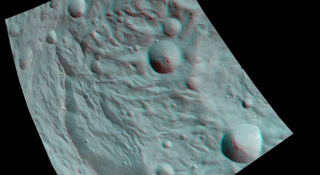 This anaglyph image from NASA's Dawn spacecraft shows the topography of asteroid Vesta's south polar region. The material at the base of the scarp (right side) is probably due to landsliding.