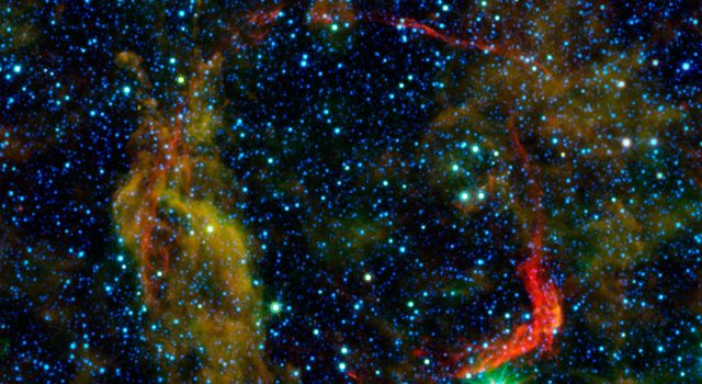 Infrared images from NASA's Spitzer Space Telescope and Wide-field Infrared Survey Explorer are combined in this image of RCW 86, the dusty remains of the oldest documented example of an exploding star, or supernova.