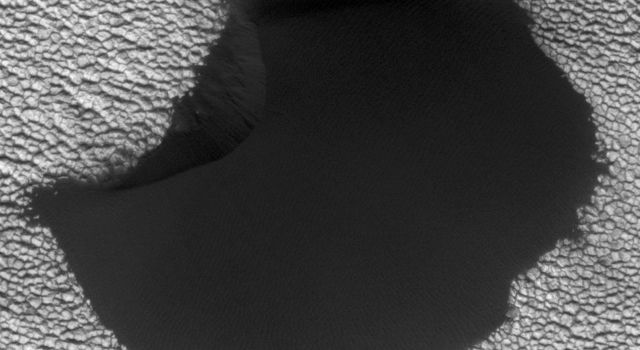 A dune in the northern polar region of Mars shows significant changes between June 25, 2008 and May 21, 2010 in one of two images taken on by NASA's Mars Reconnaissance Orbiter.