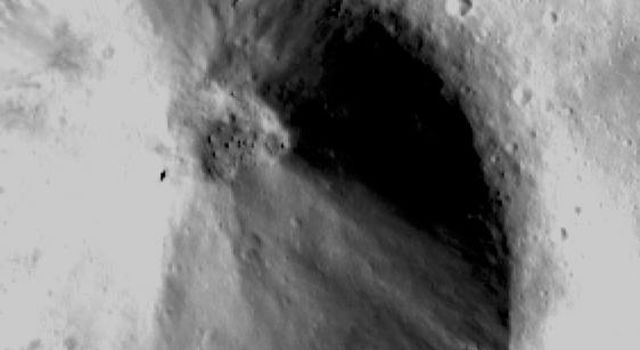 This image from NASA's Dawn spacecraft shows a fresh scarp rimmed crater with many boulders on asteroid Vesta's crater floor. These boulders have diameters of 100-200m, which is roughly the size of many asteroids.