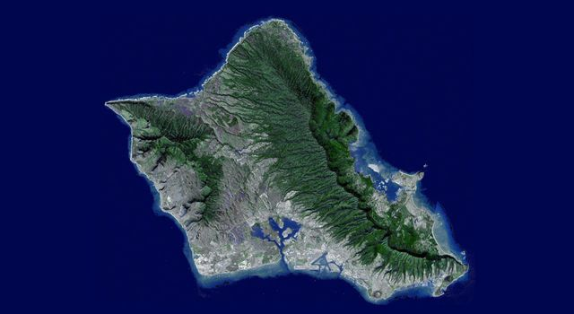Sometimes called 'The Gathering Place,' Oahu is the third largest of the Hawaiian Islands. This image was captured by NASA's Terra spacecraft. A flyover was created by draping ASTER image data acquired January 13, 2010.