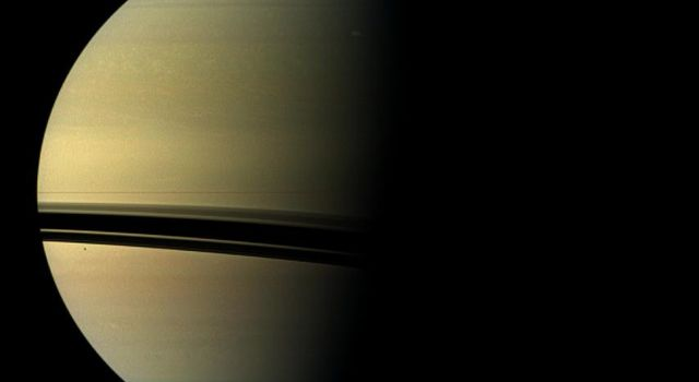 The largest storm to ravage Saturn in decades started as a small spot seen in this image from NASA's Cassini spacecraft on Dec. 5, 2010 -- the same day Cassini also detected frequent lightning signals.