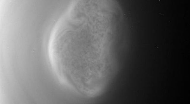 This image from a movie captured by NASA'S Cassini spacecraft shows a south polar vortex, or shows a south polar vortex, or a swirling mass of gas around the pole in the atmosphere, at Saturn's moon Titan.