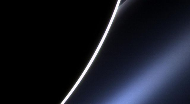 Dawn on Saturn is greeted across the vastness of interplanetary space by the morning star, Venus, in this image from NASA's Cassini spacecraft. Venus appears just off the edge of the planet directly above the white streak of Saturn's G ring.