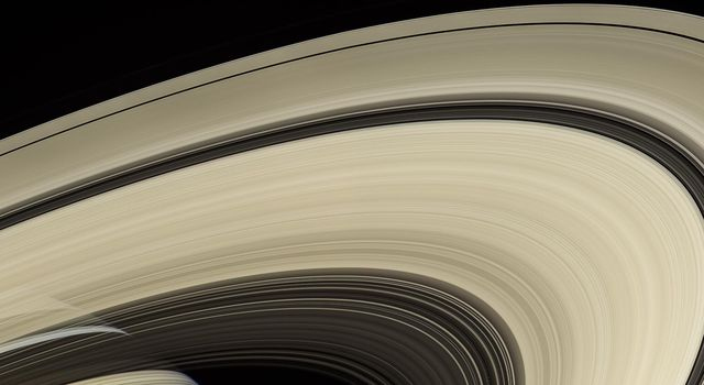This image from NASA's Cassini spacecraft shows that the rings of Saturn are made mostly of particles of water ice that range in size from smaller than a grain of sand to as large as mountains.