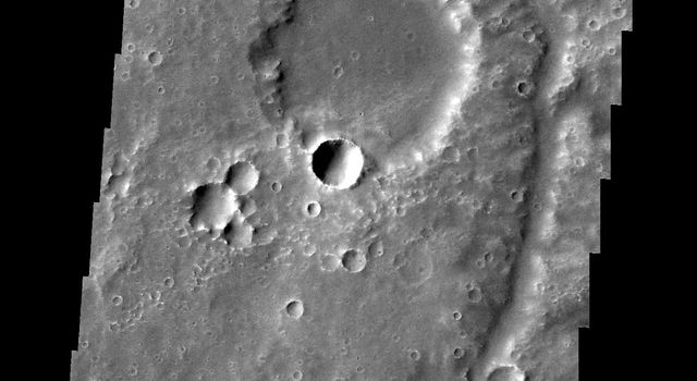 An unnamed channel drains a high standing region in Tyrrhena Terra in this image captured by NASA's 2001 Mars Odyssey spacecraft.