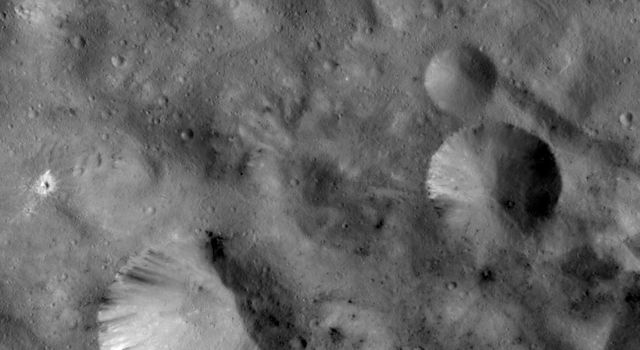 This image from NASA's Dawn spacecraft shows craters with both sharp and smooth rims. The most obvious is the large crater in the bottom left of the image.