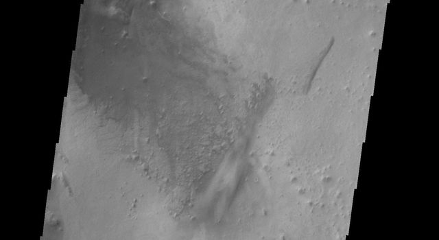 The dunes in this unnamed crater in Aonia Terra are coalescing into a sand sheet in this image from NASA's 2001 Mars Odyssey spacecraft.