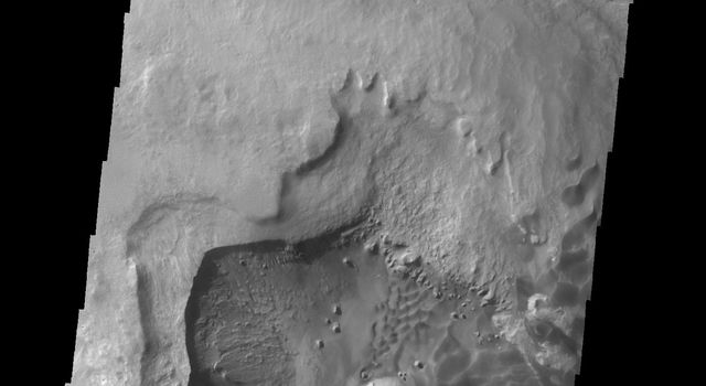 This image from NASA's 2001 Mars Odyssey spacecraft shows a portion of the depression on the floor of Rabe Crater.