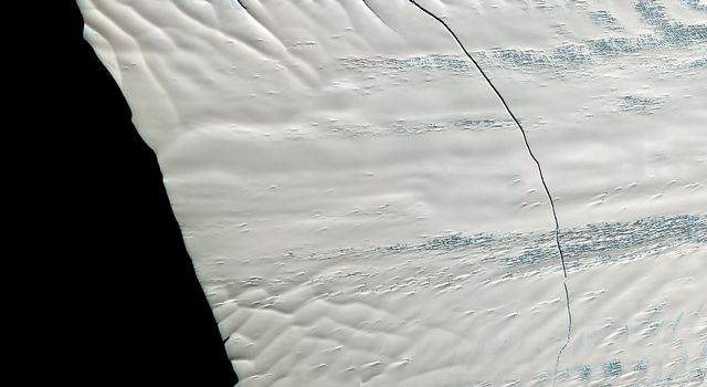 This image from NASA's Terra spacecraft shows a massive crack across the Pine Island Glacier, a major ice stream that drains the West Antarctic Ice Sheet. Eventually, the crack will extend all the way across the glacier.