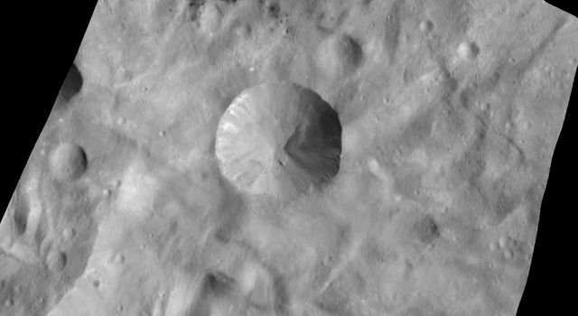 This image from NASA's Dawn spacecraft is centered on the Sextilia crater in asteroid Vesta's southern hemisphere. Craters on Vesta are named after Vestal virgins, priestesses of the Roman goddess Vesta.