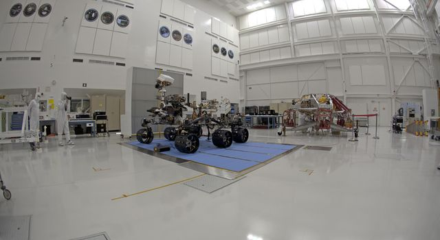 Right-eye view of NASA's Curiosity rover and its powered descent vehicle pose for photographs prior to being integrated for launch at JPL's Spacecraft Assembly Facility.