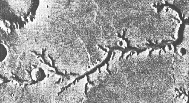 This view of channels on Mars came from NASA's Mariner 9 orbiter. In 1971, Mariner 9 became the first spacecraft to enter orbit around Mars.