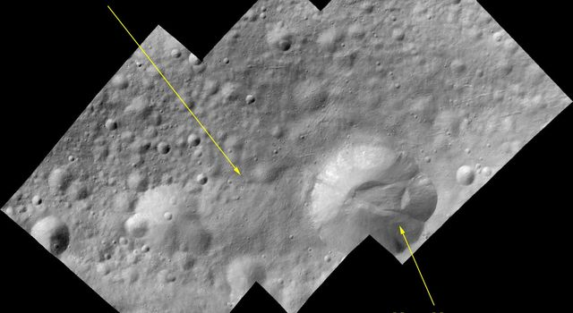 This image of a bright-rayed crater on giant asteroid Vesta was taken by the framing camera aboard NASA's Dawn spacecraft. The crater is about 2 miles (3.5 kilometers) in diameter and impacted on the rim of an older crater, named Tuccia.