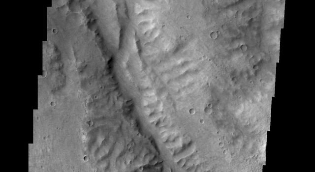 This unnamed as seen by NASA's 2001 Mars Odyssey spacecraft channel drains part of Margaritifer Terra.