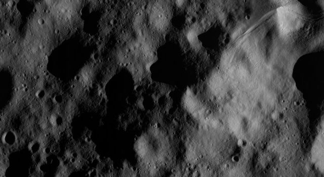 This image of the giant asteroid Vesta was obtained by NASA's Dawn spacecraft in the evening Nov. 27 PST (early morning Nov. 28, UTC), as it was spiraling down from its high altitude mapping orbit to low altitude mapping orbit.
