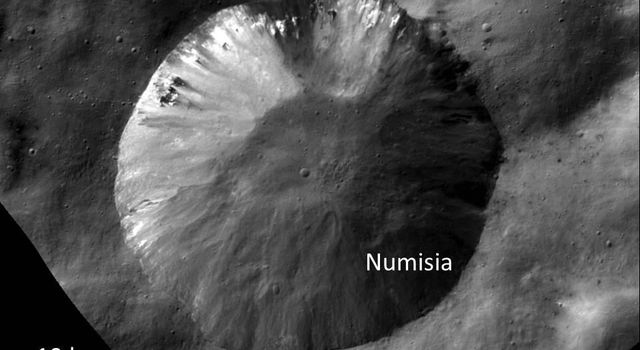 This image from NASA's Dawn spacecraft shows the crater Numisia, located just south of the equator in the Numisia quadrangle on asteroid Vesta.
