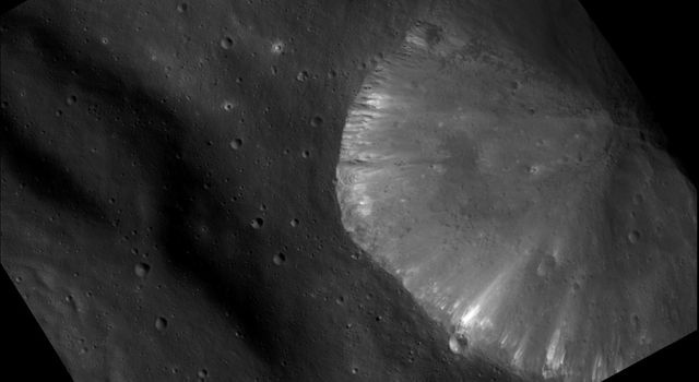 This image from NASA's Dawn spacecraft shows the brightest area seen on asteroid Vesta so far. It shows a crater located inside the rim of the Rheasilvia basin at the south pole of Vesta.