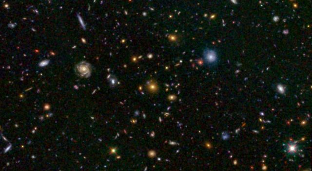 This image from NASA's Hubble telescope shows one of the most distant galaxies known, called GN-108036, dating back to 750 million years after the Big Bang that created our universe. The galaxy's light took 12.9 billion years to reach us.