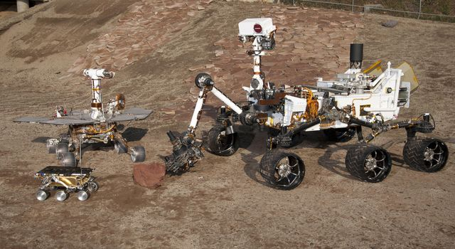 Three Generations of Rovers in Mars Yard