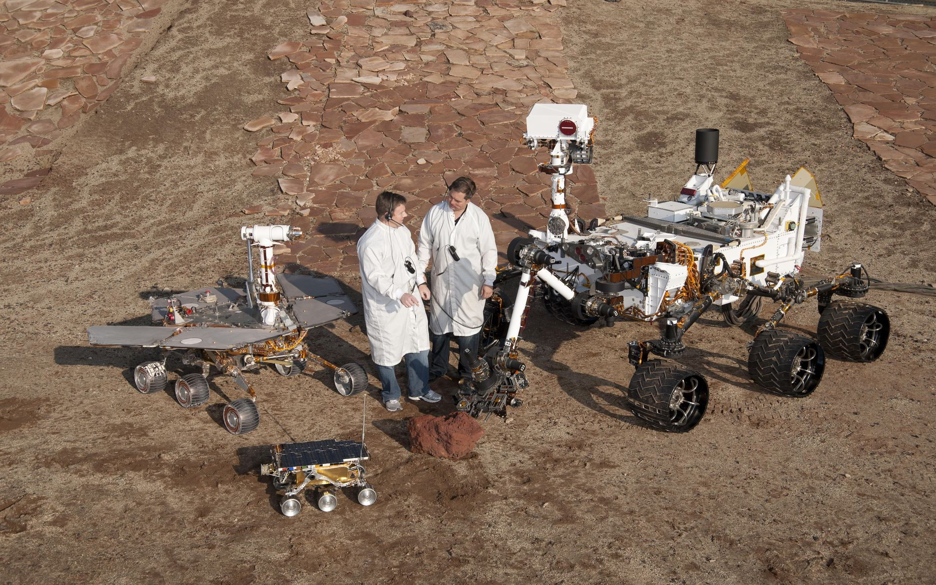 Space Images | Three Generations of Rovers with Standing Engineers