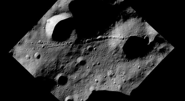 This image from NASA's Dawn spacecraft shows a surface with many craters and linear chains of small craters that merge into ridges on the giant asteroid Vesta.