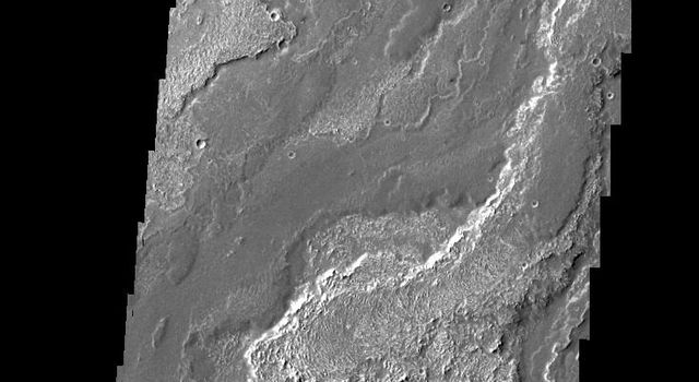 Daedalia Planum is comprised of lava flows from Arsia Mons. This image was captured by NASA's 2001 Mars Odyssey spacecraft.