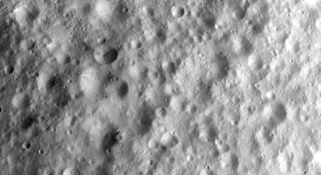This image from NASA's Dawn spacecraft shows heavily cratered terrain in asteroid Vesta's equatorial region. The craters have a wide range of sizes and many different forms, which include fresh, degraded and barely visible because they are so degraded.