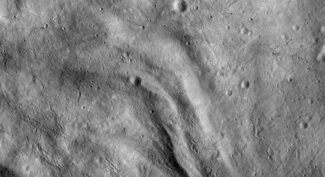 This image from NASA's Dawn spacecraft shows undulating terrain, located only in asteroid Vesta's southern hemisphere, in and around the Rheasilvia impact basin.