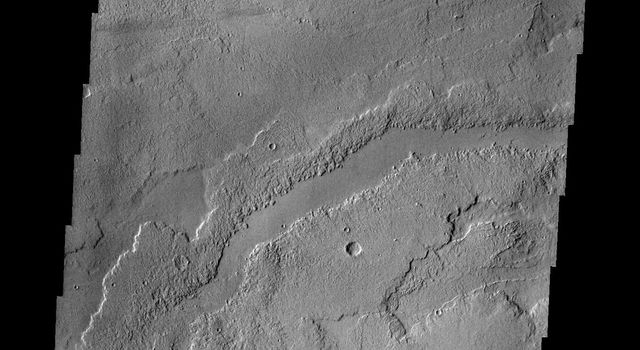 This image from NASA's 2001 Mars Odyssey spacecraft shows a small portion of the vast lava flow fields between Echus Chasma and the main Tharsis volcanoes.