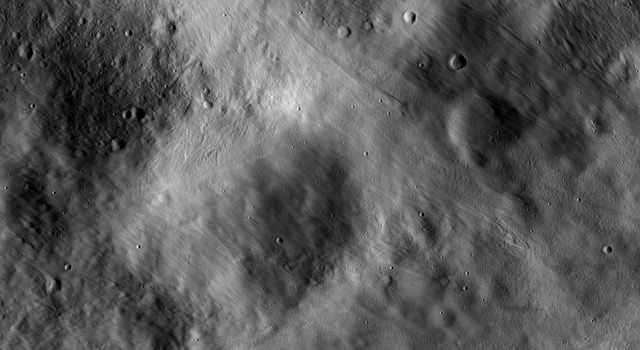 This image from NASA's Dawn spacecraft shows impact ejecta deposits dominating asteroid Vesta's landscape. This impact ejecta material was ejected from an impact crater located outside the imaged area.