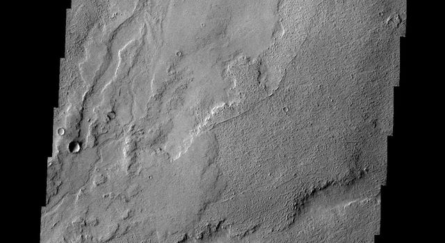 This image captured by NASA's 2001 Mars Odyssey spacecraft shows a small portion of the volcanic flows in the Tharsis region.