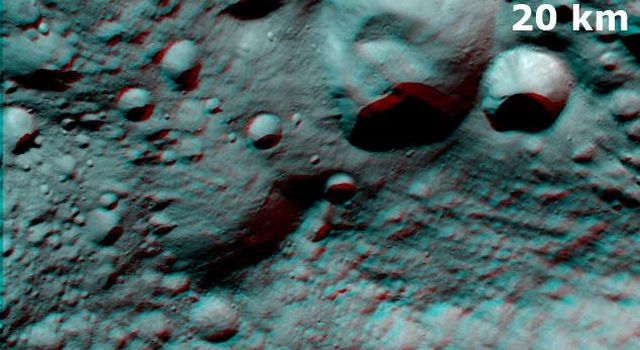 This anaglpyh from NASA's Dawn spacecraft shows Caparronia crater on asteroid Vesta. The 3-D effect of the anaglyph highlights the large ridge running across the base of Caparronia crater. You will need 3-D glasses to view this image.